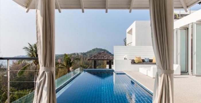 Villa Sammasan-1. Villa Sammasan - Sun loungers by the pool.png